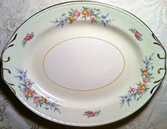 This lovely floral vintage platter has handles! - Southern Vintage Table
