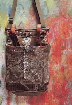 Junko Oki..bag can be bought from Army Navy Surplus minus the artistic repurposing