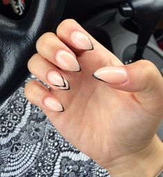 Nude stiletto gel nails with black tips! So simple and tasteful!
