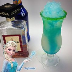 The Elsa Cocktail (from Frozen)  (*Bottom Layer* 1 oz Coconut Rum 1 oz Amaretto  1/2 oz Blue Curacao *Top Layer* 1 oz Coconut Rum 2 oz Lemon Lime Soda Splash Blue Curacao)
