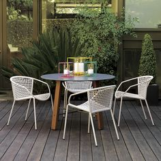 Create a stylish outdoor space. With colorful outdoor chairs and tables, understated seating and consoles, our modern outdoor furniture makes alfresco entertaining simple.