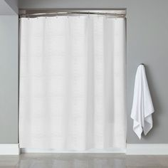 Modernize your bathroom style with this shower curtain featuring embossed stripes and rustproof grommets.OVERSTOCK. COM