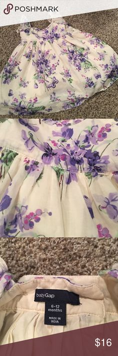 Baby GAP dress Girls baby gap dress.  Cream colored with accents of purple. Green and pink.  Full of flowers and butterflies. Worn once GAP Dresses Formal
