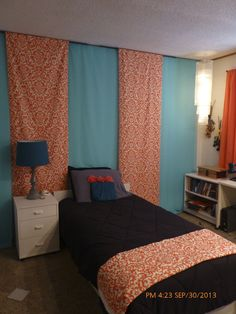 Coral and turquoise with mixed accents of yellow, dk turquoise and black. Mydaughter's room was dingy...couldn't do paint or nails in the walls (a rental), so used material and 3M command strip hooks!