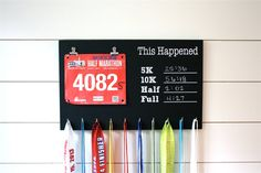 Painted with black chalkboard paint. There are places to record your PRs (personal records) in the 5K, 10K, half marathon, and full marathon. Chalk