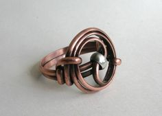 'Copper Yin/Yang Ring' is going up for auction at  2pm Thu, Jun 7 with a starting bid of $7.