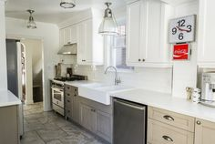 White, beige, and grey modern/traditional kitchen in old house, subway tile