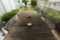A wooden ipé deck and artificial lawn cover the terrace. A social setting on either end of the terrace allows visitors to view the owners art piece.