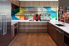 Geometric backsplash. Bright, bold and eye catching, a feature like this is sure to be a centerpiece. You can achieve a similar look with mosaic tile or by carefully applying paint.  www.houzz.com/ideabooks/23233269/list/12-Ideas-for-a-Knockout-Kitchen