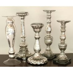 Portrait of Bring Romantic Feeling for Christmas with Mercury Glass Candlesticks