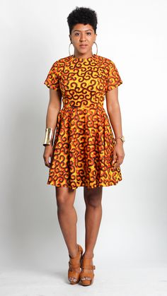 An A Leap of Style bestseller, The Von Me Dress is an african print fit and flare dress that is flattering on a variety of figures. Try this short sleeve, orange and yellow ankara dress on for size! T