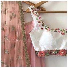 The Sophia Mogra Lehenga Set . Stunning white crop top and pink color lehenga. Look very classy. 19 June 2017