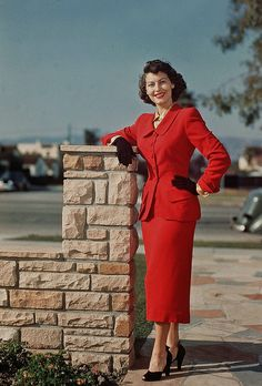 Ava Gardner looking as beautiful as a rose in a smart red suit.