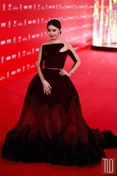 Fan Bingbing attends the 2015 Shanghai International Film Festival Opening Ceremony in Shanghai, China in a Stéphane Rolland couture gown from the Fall 2014 collection accessorized with Chopard jewelry.