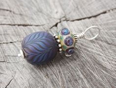 Etched blues and purple feather pattern lampwork bead pendant with Balinese and sterling silver