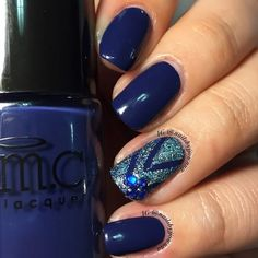 Lend a touch of sophistication your basic blue manicure with holographic polish and bling on your accent nail. DIY with the nail art essentials found here.