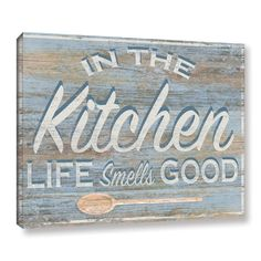 'In the Kitchen' Textual Art on Wrapped Canvas is a delightful reproduction featuring a rustic wood grain sign. A wonderful conversation piece that will compliment any home or office.