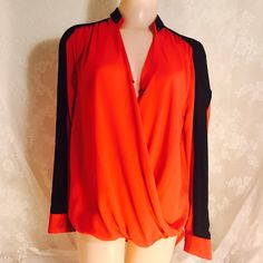 Red and black blouse. Red and black blouse. 100% Polyester. Beautiful long sleeves blouse! One of a kind. Back side is couple of inches longer. One snap botton in front. RolyPoly Tops Blouses
