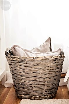 Pillows in a basket!!! Duh! This is how we can have more than 4 pillows in the living room and not overflow the couch.