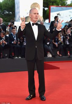 Michael Keaton, Peace, man! The 62-year-old looked dapper in a black suit and bow-tie ...2014 Venice Film Festival