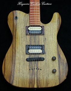 This Haywire Custom Telecaster is a solid Korina Carved top body  with a contoured heel and an arch string through body design and recessed tune-o-matic bridge. Installed are a matched set of  black and cream Seymour Duncan Pearly Gates Humbuckers wired with a push pull volume knob which splits the coils in both pickups. http://www.haywirecustomguitars.com