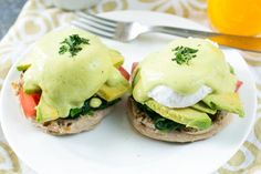 California-Style Eggs Benedict is topped with a gorgeous tomato hollandaise. A great way to shake up your favorite egg dish!