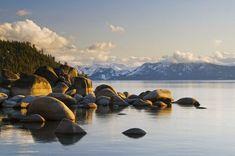 Golden afternoon light illuminates granite boulders on the east shore of Lake Tahoe, NV.