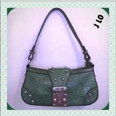 """J Lo reptile Croco green hobo silver studded bag Beautiful reptile green Croco bag by J Lo! Not only does the Croco look just like reptile it is studded perfectly with silver studs as you see in the picture to create a magnificent style! Has a push button lock which is more secure than turn lock bags! V-shaped front flap, zip closure, studs on sides front & flap, pink plaque, 1zip/1ID SLIP, signature lining, 10x5x3 inches w/strap drop of 9.5"""", view all pics closely as part description, all…"""