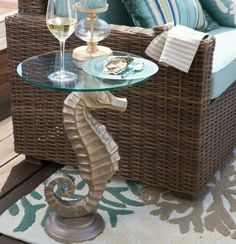 Seahorse Table with Glass Top...  http://www.completely-coastal.com/2016/01/coastal-nautical-accent-tables-side-end-tables.html