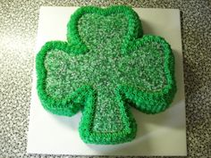 - White cake colored green and covered in vanilla buttercream
