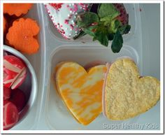 When in doubt for what to make your kids (or your spouse) for a special Valentine's lunch? Just turn everything into heart shapes. This website gives you an entire Valentine's week meal plan, like these pita crisps with cheese and veggies.