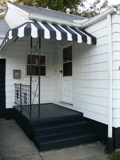 Front porch gets a fresh coat of paint. It use to be several shades of green also had outdoor carpet on it.