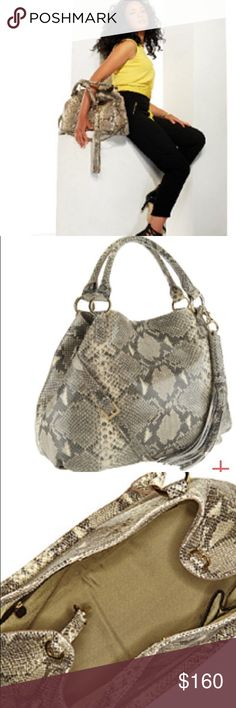 "G.I.L.I. Soft snakeprint handbag Roma 2/3 8/10 cond/super clean inside/out/duster included. Style: Roma 2 maybe 3 Gold hardware; double handles; removable, adjustable strap; hanging tassel; center magnetic snap closure; back-wall zip pocket, two front-wall slip pockets: 16""W x 12""H x 6-1/2""D;16""-18""  strap drop & 7"" handle drop; Body/trim 100% leather; lining 80% polyester/20% cotton. Selling for my friend, wiggle room for decent offers. No odors and non smoking individual/home. Stunning…"