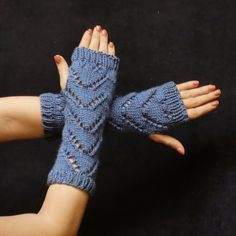 Fingerless gloves are the perfect accessory for summer or winter. These hobo mitts are knit with soft country blue yarn, a lace chevron pattern, #fashiongloves #armwarmer #gloves #fingerlessgloves #wristwarmer #blue #cuffs #lace