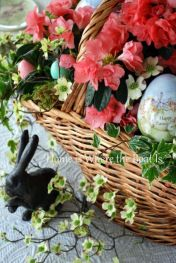 Home is where the boat is centerpiece. ..azaleas/ivy/decorative eggs/rattan basket. ..