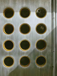scandinaviancollectors:  An aluminium door by Jean Prouvé, late 1940s, France. / Elle Decor 2011