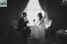 The bride & groom by the window light. Weddings at Conyngham Arms Hotel, Slane, by Couple Photography.