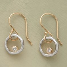 """Diamonds set in polished 14kt gold glimmer within matte sterling silver rings. 14kt French wires. Handmade in USA. Diamond placement may vary. 3/4""""L."""