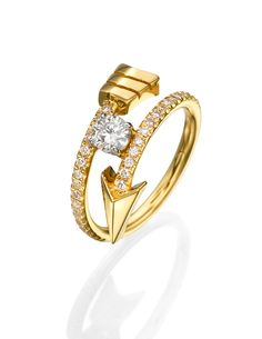 The FLOW collection ~ An 18k yellow gold arrow ring set with a diamond in the center, adorned with diamonds