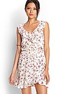 A sleeveless floral dress featuring ruffled trim and a cutout back. Complete with an elasticized waist.