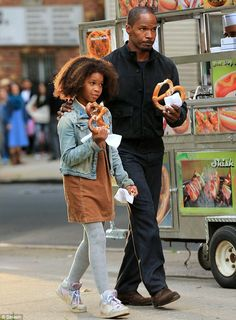 Modern musical: Quvenzhane plays Annie while Jamie is her guardian angel billionaire