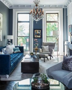 Beautiful Eclectic style all blue living room decor with blue velvet tufted sofa and grey armchair Beautiful Eclectic style all blue living room decor with blue velvet tufted sofa and grey armchair, blue decor, cobalt blue living room with blue sofa Blue Velvet Sofa Living Room, Blue Living Room Decor, Glam Living Room, Blue Living Room Furniture, Space Furniture, Living Room Ideas Grey And Blue, Grey Living Room Inspiration, Armchair Living Room, Living Room With Grey Sofa