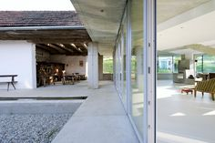 Wood Store, Terrace, Patio Doors, Old Farm House Renovation and Expansion in Burgenland, Austria