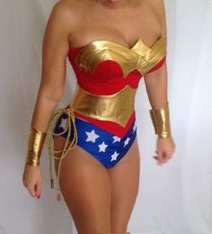 """Piece Sexy """"Wonder Woman"""" Costume Includes: Faux red leather corset with front metal closure and lace-up back for cinching, Gold Headband, Gold Gloves, and Shimmery blue brief with white stars. Description from pinterest.com. I searched for this on bing.com/images"""