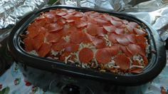 I put together a PIZZA CASSEROLE ABLE TO FEED 40 PEOPLE. It turned out great. If you have to feed a big crowd and are looking for a really reasonable way to do it, check out my post for PIZZA CASSEROLE IN A ROASTER on the Barn Door. (The $100 included the sides/dessert!) http://www.thebarndoor.net/2013/09/recipe-meal-idea-for-big-crowd-or.html