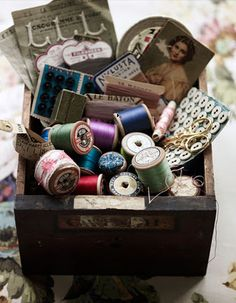 A lovely array of vintage spools of thread and various sewing notions. #vintage #sewing