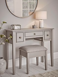 With a warm grey painted finish and three drawers with simple round metal handles, our elegant Camille dressing table is the perfect way to store essentials in your bedroom. Chic and compact, it fits snugly against your wall. Dressing Table With Drawers, Small Dressing Table, Furniture Dressing Table, Bedroom Dressing Table, Vintage Dressing Tables, Dressing Table Design, Modern Vintage Bedrooms, Vintage Bedroom Furniture, Bedroom Vintage