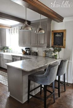 The Finishing Touches on Our Kitchen Makeover (Before and Afters).... I love the beams