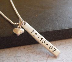 LOVE THIS!! I have a small heart with my husbands name on it, and love that.  Now I want this as a second necklace with our wedding date on it! So simple and beautiful! :)