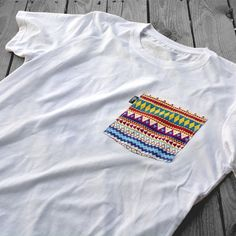 if you've got a tee or button up that needs a simple spruce but you have zero sewing skills, try out a no-sew pocket that looks great without...